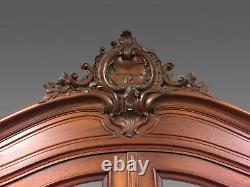Bureau de pente formant bibliothèque en noyer sculpté style Louis XV 1900