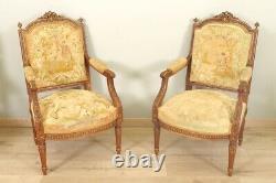 Paire de fauteuils style Louis XVI tapisserie petit point