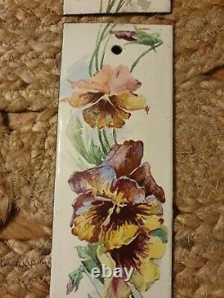 Plaques de propreté émaillées anciennes décor de fleurs pensées style C. Klein