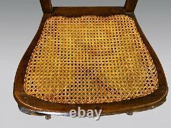 Six chaises de salle à manger cannées style Louis XV