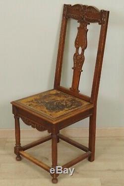 Suite de douze chaises de salle à manger style Renaissance 1900